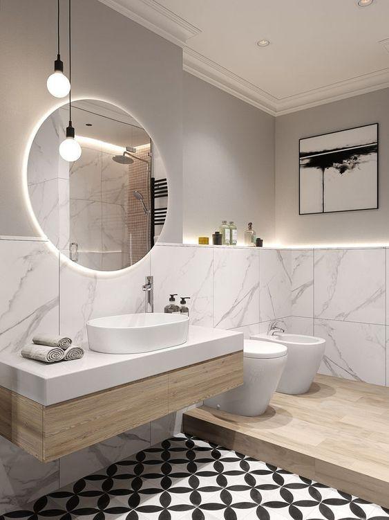 ronde spiegel met verlichting idee voor de badkamer