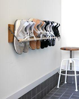 smalle hal inrichten met een schoenen rek