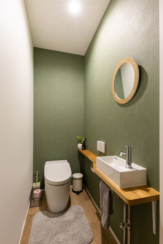 modern olijf groen toilet met houten wastafel