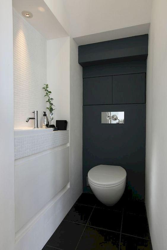 modern zwart wit toilet ontwerp met zwevend toiletpot en zwart muur