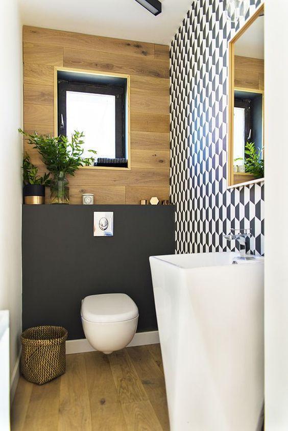modern toilet met zwarte watercloset en witte wastafel