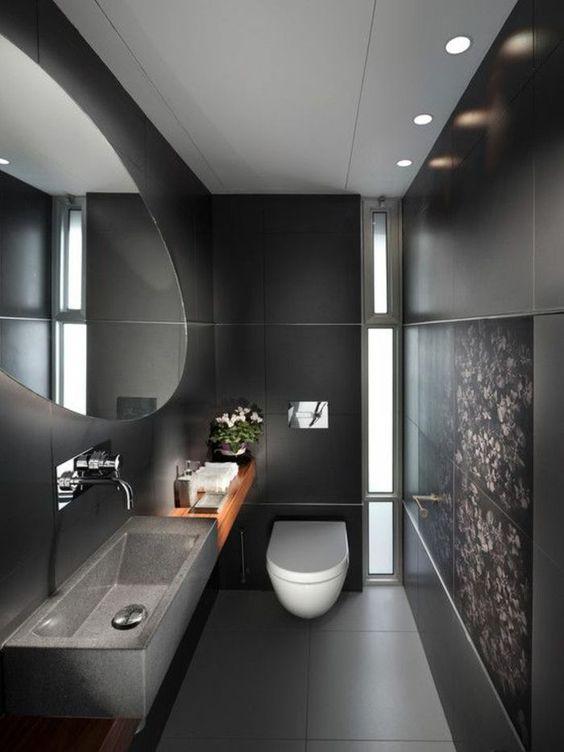 modern wc met antracieten natuurstenen muren