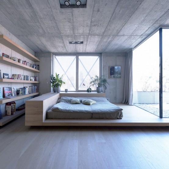 boekenkast idee in moderne woning met bed voor kast slaapkamer