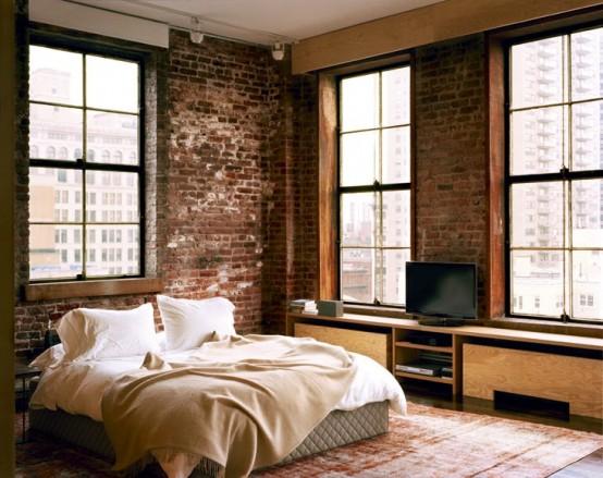 bakstenen muur in industriele loft slaapkamer